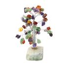 Дерево из самоцветов  на каменной подста...